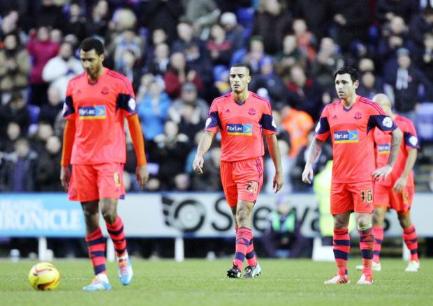 Bolton Wanderers players, from left, David Ngog, Darren Pratley and Mark Davies hang their heads in shame