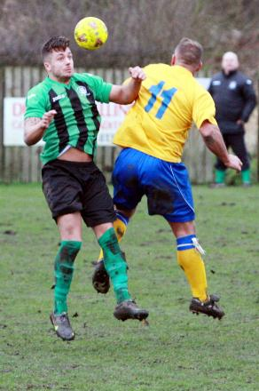 Tempest two-goal star Tom Booth wins a header during Saturday's game against Charnock Richard. Picture by Ken Chapman