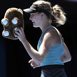 Eugenie Bouchard, pictured, will face Li Na in the semi-finals (AP)