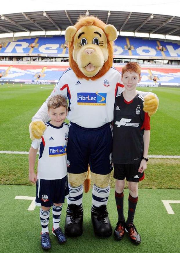 The Bolton News: Super-fan Bobby Oysten, left with club mascot Lofty the Lion and t