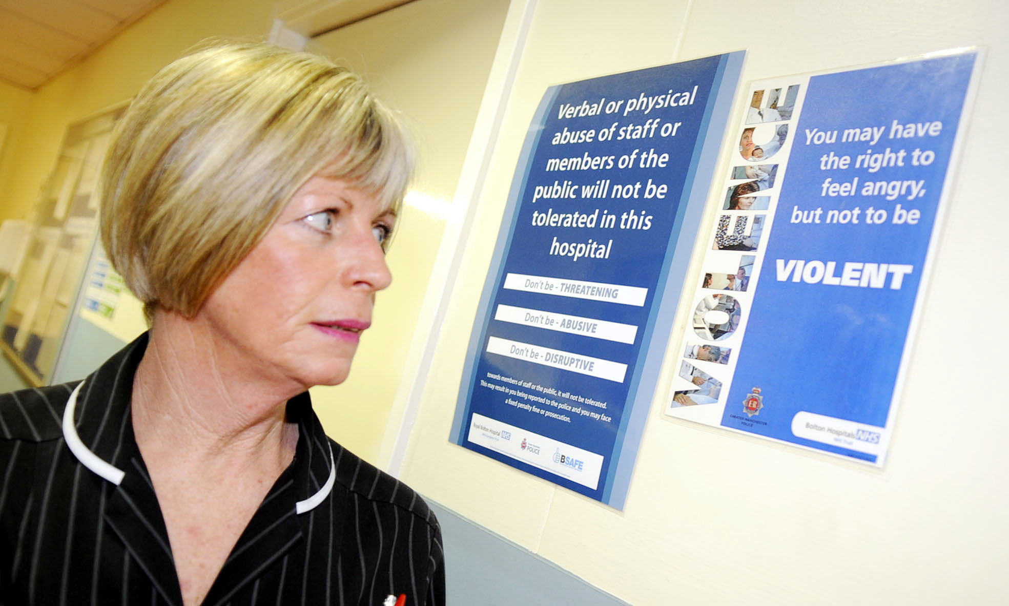 Sue Beswick, matron in A&E at Royal Bolton Hospital with one of the warning notices