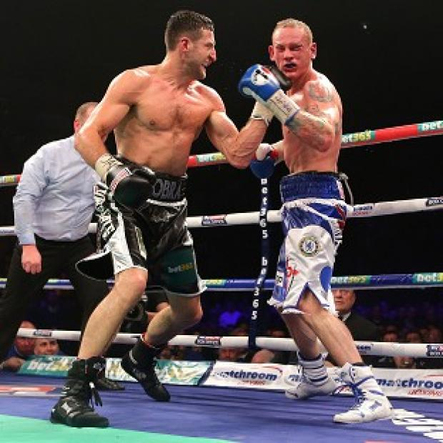 The Bolton News: Carl Froch, left, beat George Groves, right, in their controversial bout in November