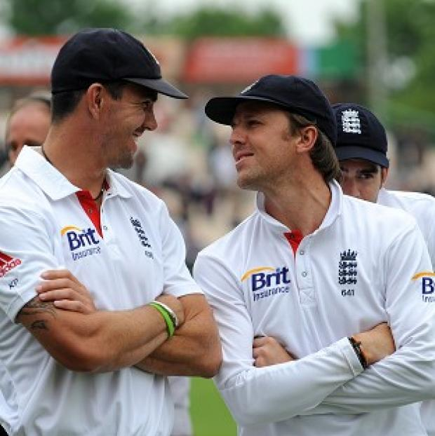 The Bolton News: Graeme Swann, right, has backed Kevin Pietersen, left, to continue his England career