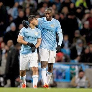 Sergio Aguero, left, scored a second-half hat-trick to spare Manchester City's blushes on Saturday