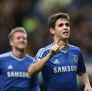 The Bolton News: Oscar, right, scored the only goal of the game as Chelsea booked their place in the FA Cup fifth round