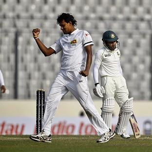 Suranga Lakmal celebrates taking the wicket of Bangladesh captain Mushfiqur Rahim (AP)