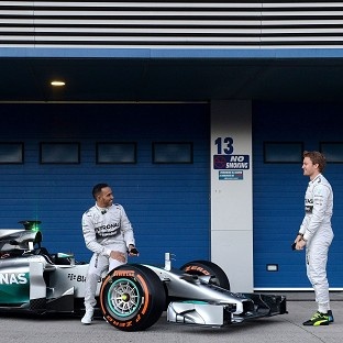 Lewis Hamilton, left, and Nico Rosberg unveil the new Mercedes W05 in Jerez