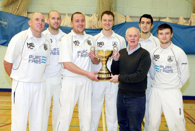 Bolton League chairman Mike Hall presents the Anthony Axford Indoor Cricket trophy to Egerton captain Paul Stafford, watched by team members, from left, Anthony Clegg, Stuart Hornby, Will Halton, Declan Dudley and Danny Partington