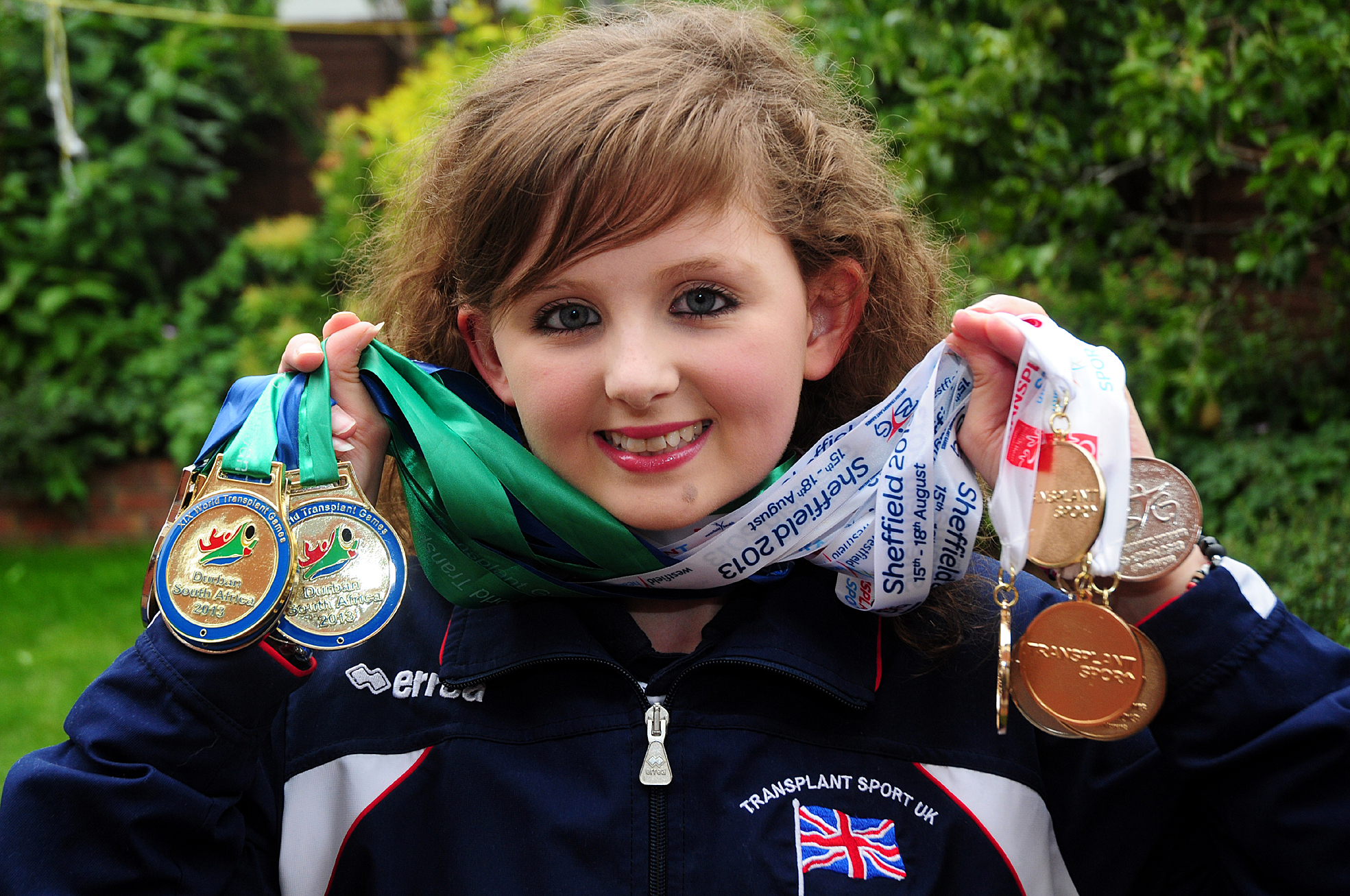 Beth Morris of Hollow Meadows, Ringley, with her medals, four gold and three