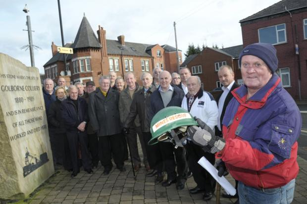 Members of the Golborne Ex-miners Association at the memorial stone