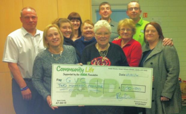 Golborne Village members collect the cheque from Asda