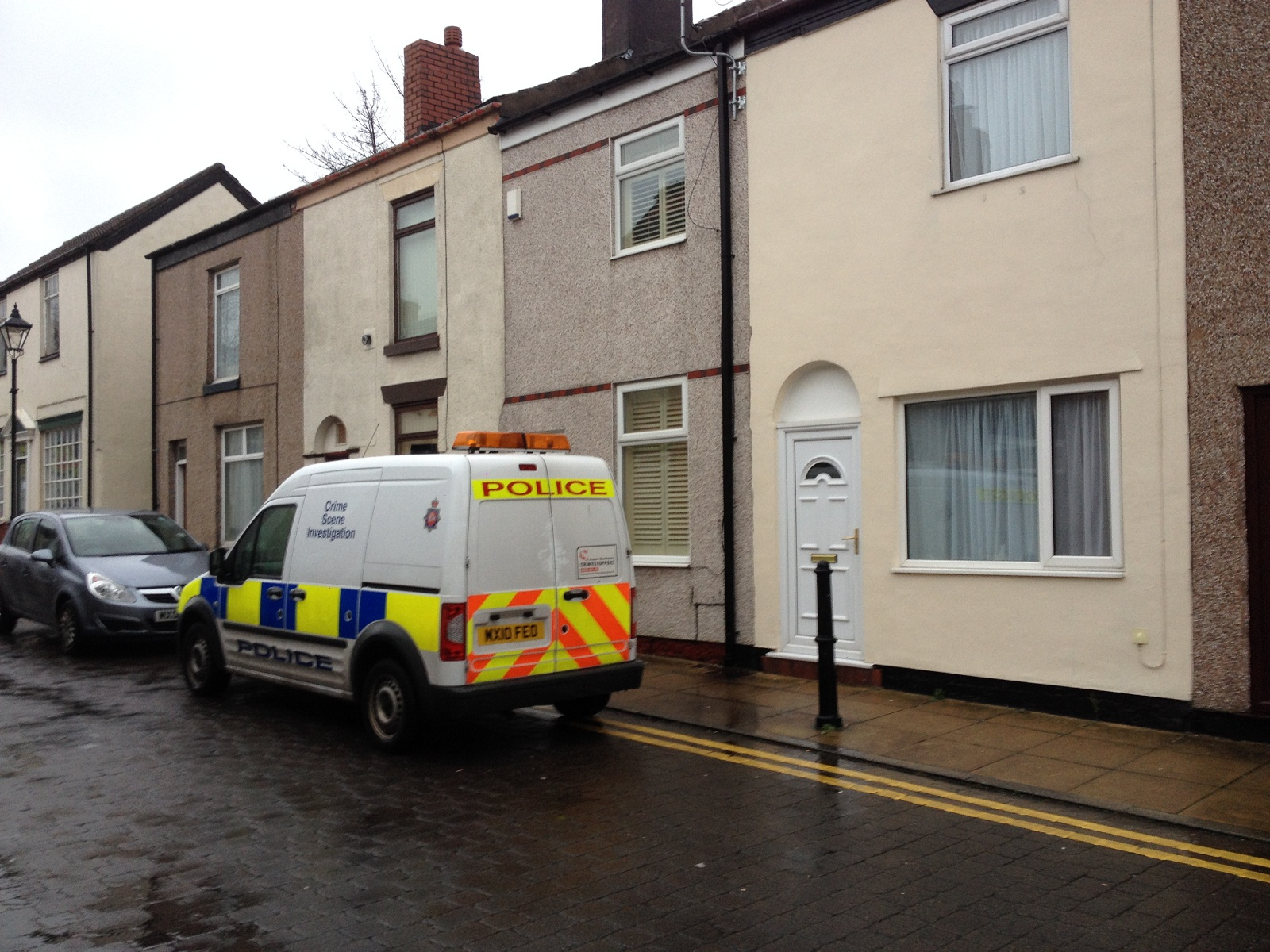 Crime scene investigators at the home in Wood Street, Westhoughton, where a woman is alleged to have been pushed down the stairs