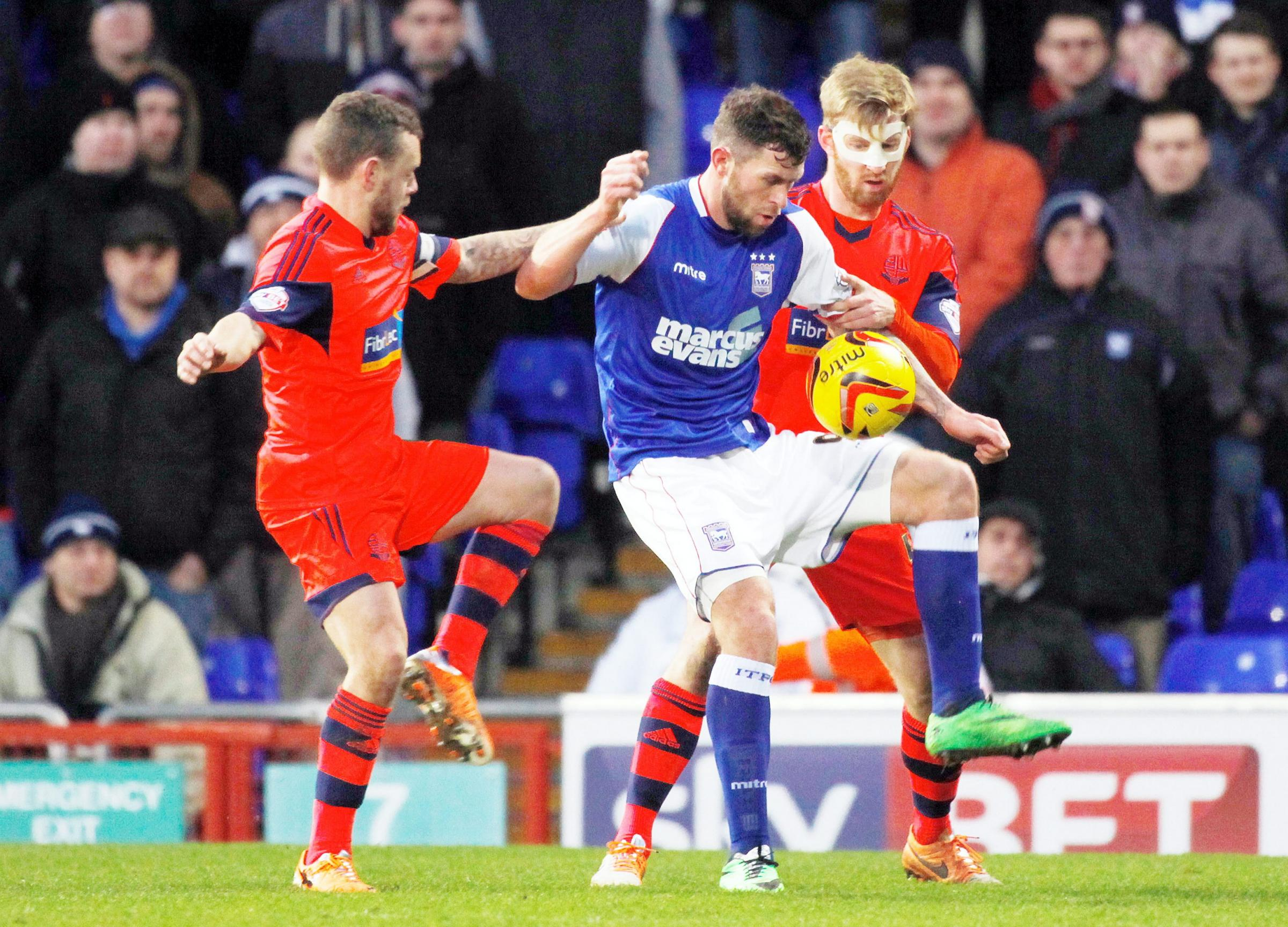 A masked Tim Ream, right, and Jay Spearing in action at Ipswich