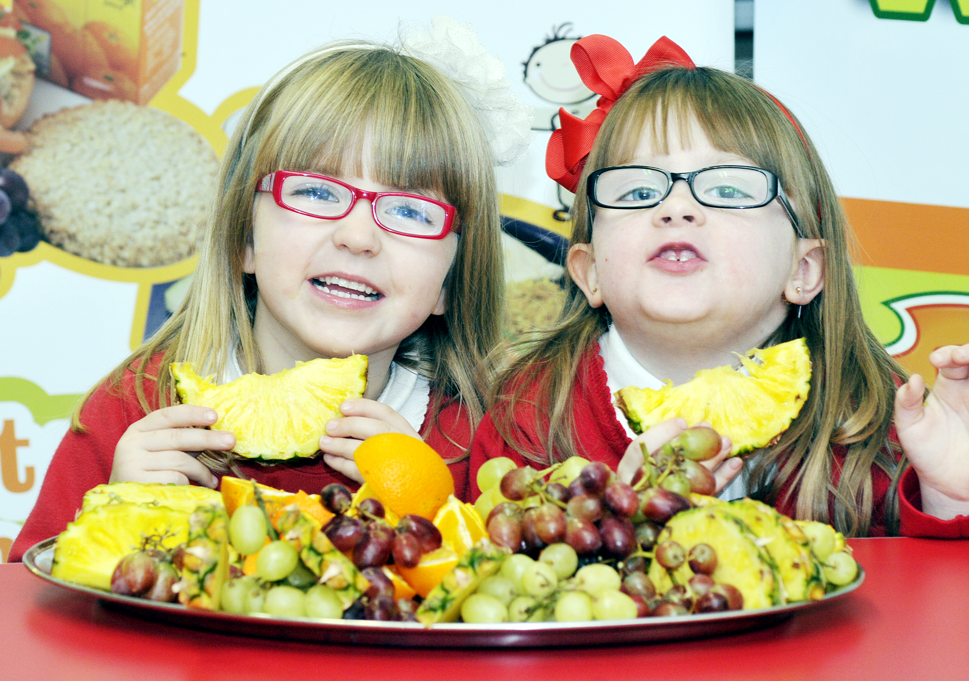 Keira Byrne and Madison Tinsley tuck into some healthy snacks at Kearsley West Primary School — the first in the country to promote the Food Dudes campaign to encourage good eating habits
