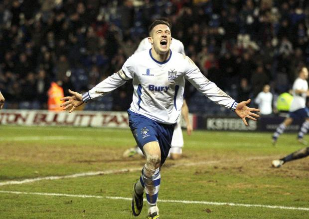 Bury captain Craig Jones celebrates scoring against Oxford United
