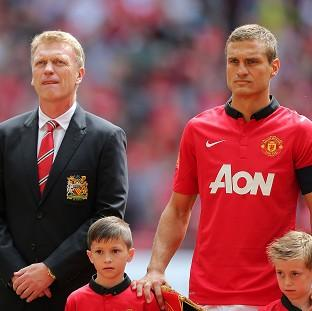 The Bolton News: David Moyes, left, reveals the decision for Nemanja Vidic, right, to leave the club was a mutual decision