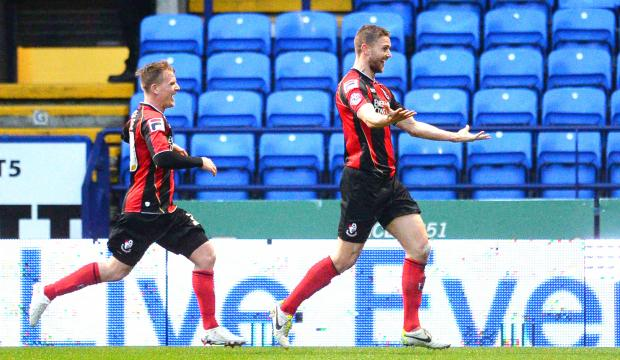 Simon Francis, right, celebrates after scoring the equaliser for Bournemouth on Saturday