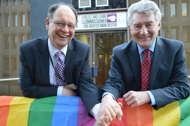 Police commissioner Tony Lloyd (right) holds hands with his deputy, Jim Battle, to support gay rights