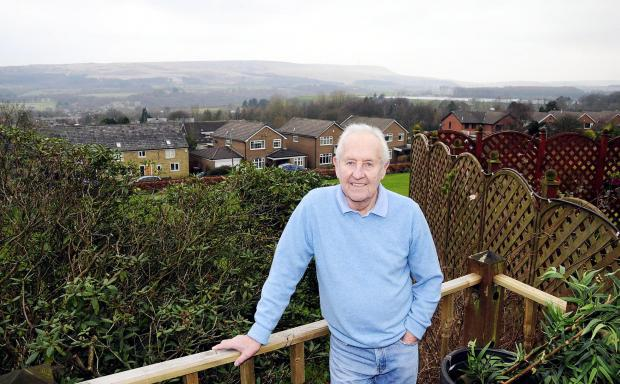 The Bolton News: Brian Caswell enjoying the view from his new home on the outskirts of Bolton
