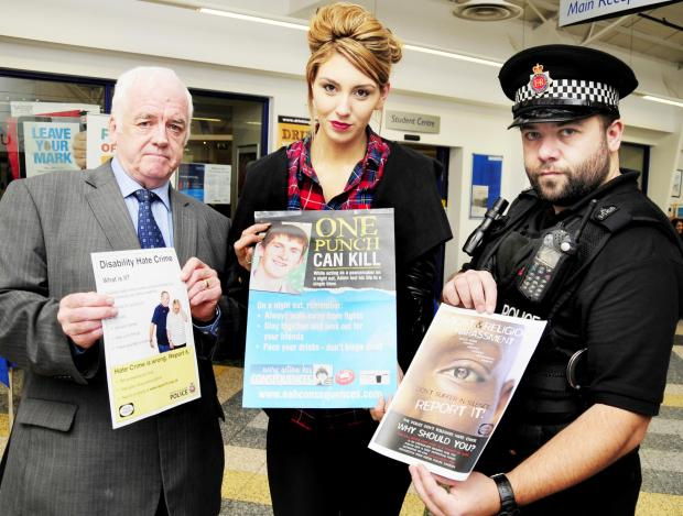 The Bolton News: From left, Cllr Derek Burrows, student Kendal Luby, aged 22, and PC Rick Charlesworth help raise awareness at the University of Bolton