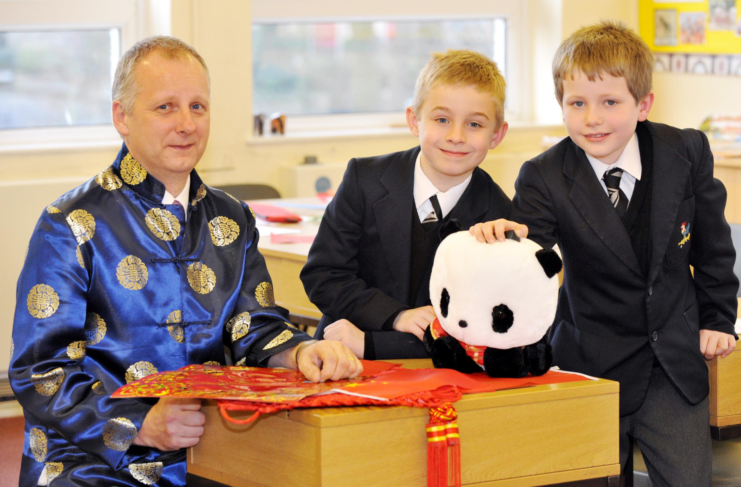 Mandarin teacher Colin Hough with pupils Saul Farrell and Charlie Ashton, both aged eight