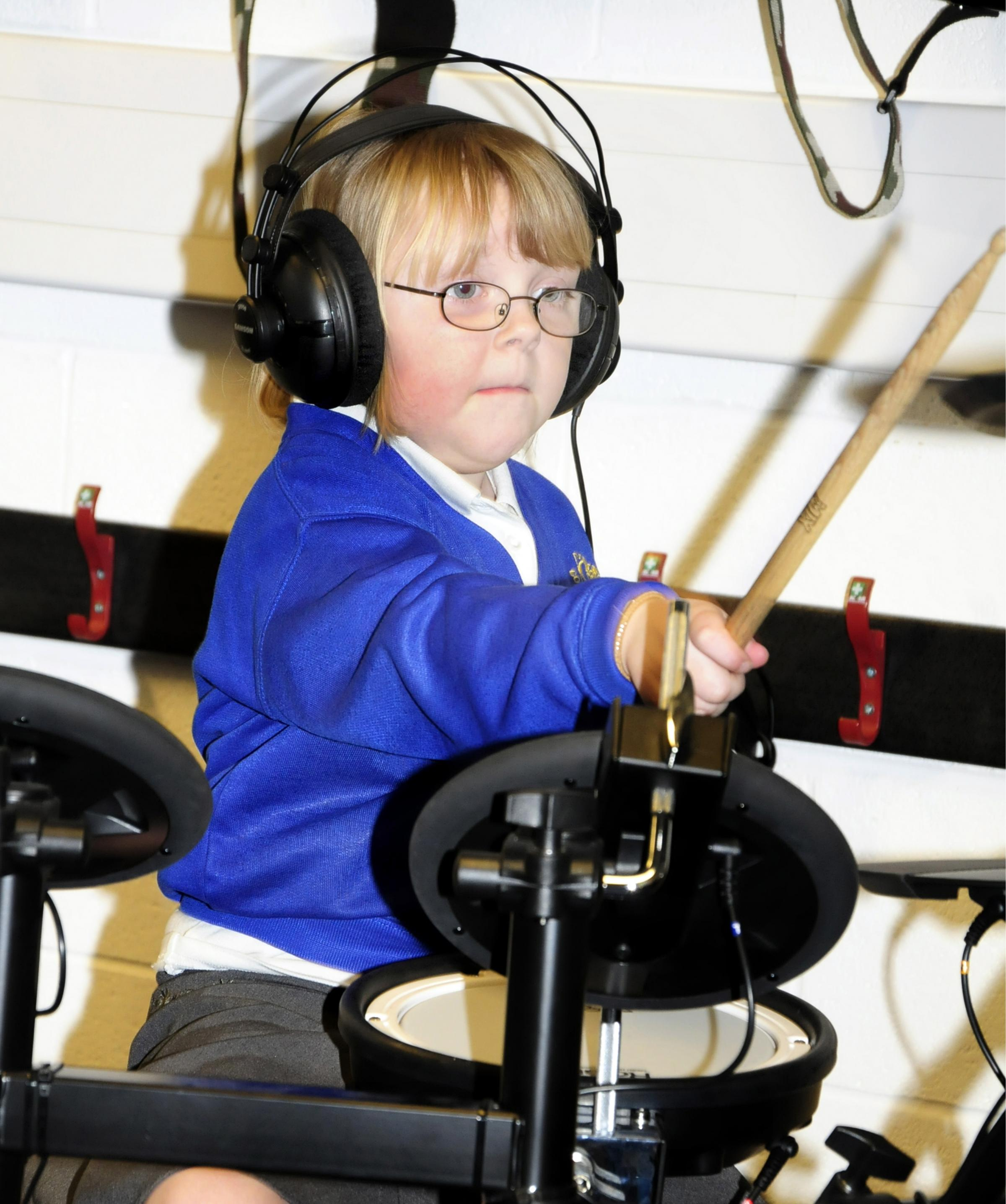 Children bang the drums in silence with Bolton Music Service