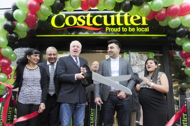 The Bolton News: Dave Spikey opens the new Costcutter, in Farnworth, with owner Baz Jethwa, front right, and staff