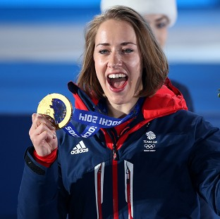 Lizzy Yarnold celebrates with her gold medal