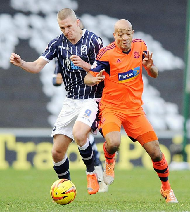 TRUE GRIT Alex Baptiste, right, battles with Millwall striker Steve Morrison for the ball