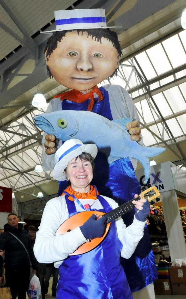 The Bolton News: Jimmy the Fishmonger and assistant Kathy Kim, of Thingumagjig Theatre, helped showcase all that was on offer in the revamped Bolton Market.