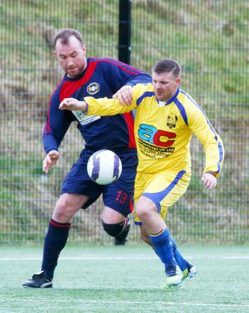 Farnworth's Lance Hall, left, challenges Heaton's Rob Walsh