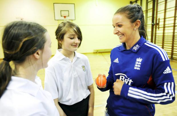 Kate Cross with Canon Slade High School pupils Charlotte Lynch and Grace Driess