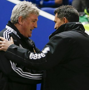 Steve Bruce, left, and Oscar Garcia will have to prepare their teams to play two games in three days