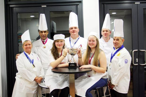 Alicia Bramwell, left, and Abbie Davies with four of the judges