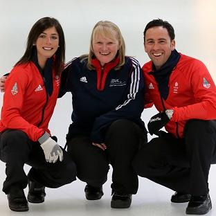 Eve Muirhead, left, and David Murdoch, right, with 2002 gold medalist Rhona Howie