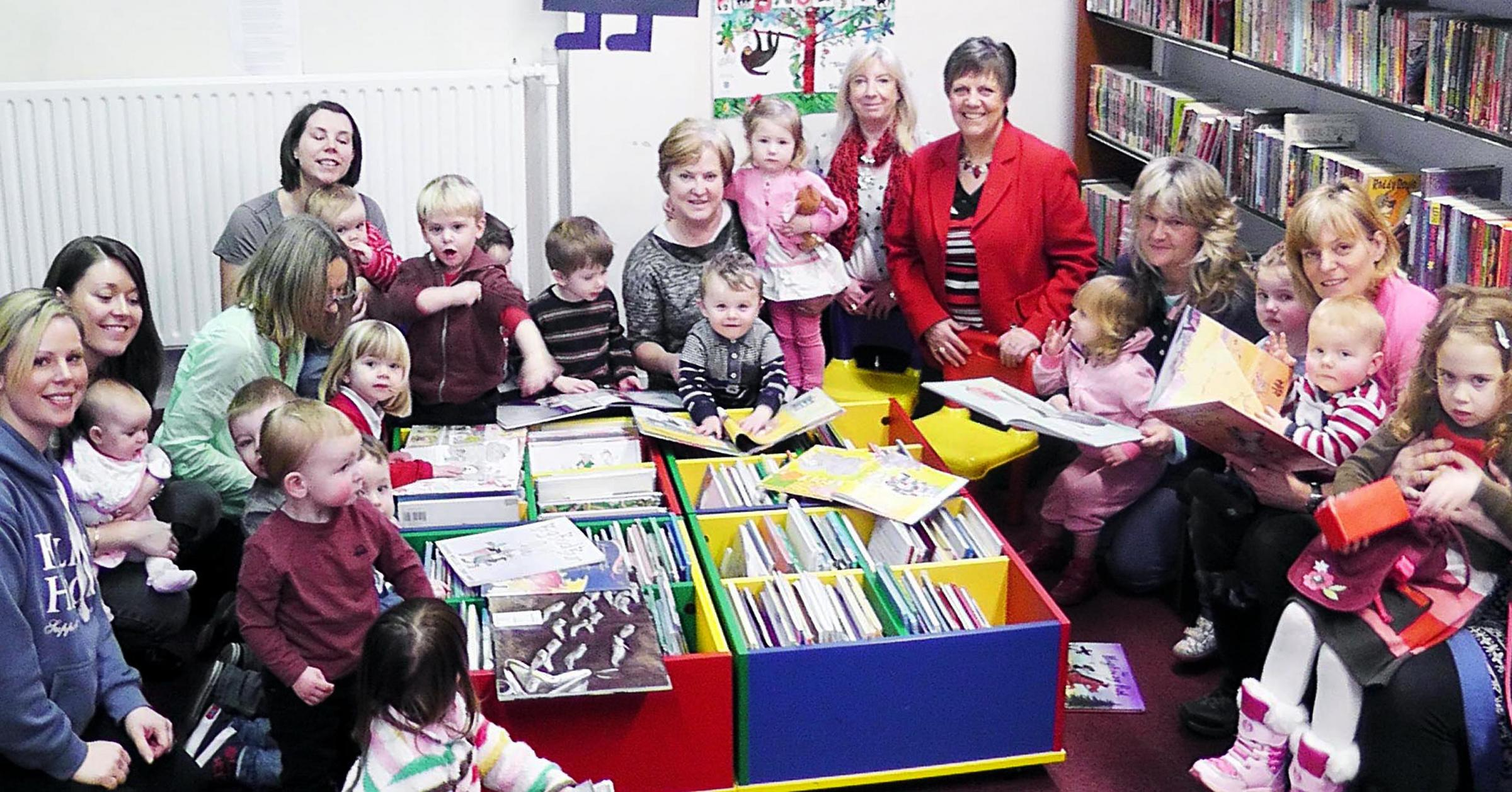Julie Hilling MP, in the red jacket, with mothers and child minders from the Toddler Tales Group