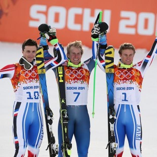 The Bolton News: Ted Ligety, centre, celebrates his gold (AP)