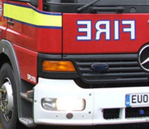 The Bolton News: Bolton firefighters tackle huge barn fire in Wigan