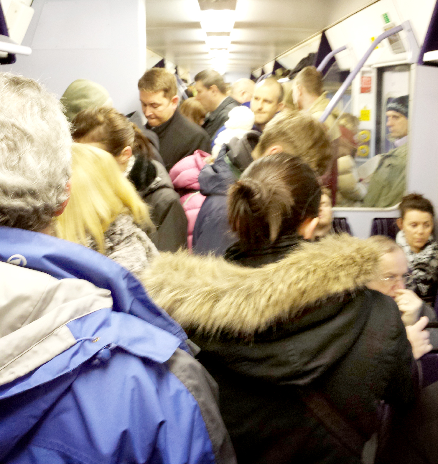 Passengers crammed on to a train