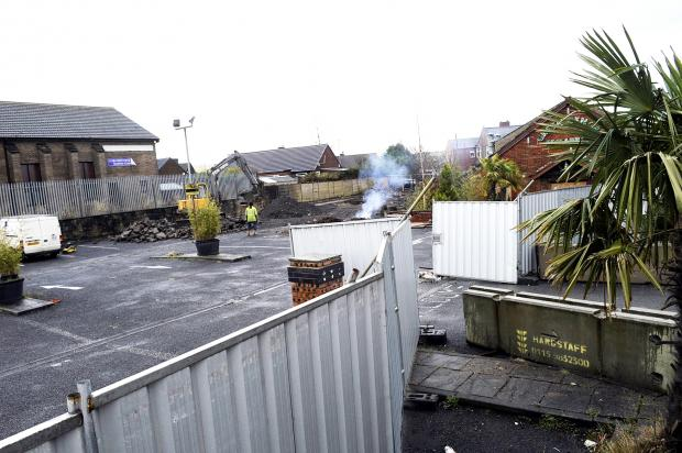 The Bolton News: A plume of smoke can be seen coming from the car park of the former Green Bengal restaurant