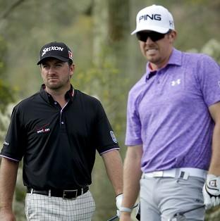 Graeme McDowell, left, defeated Hunter Mahan on the third extra hole (AP)