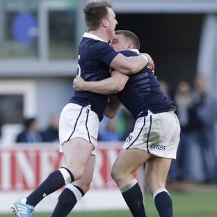 Duncan Weir, right, and Stuart Hogg celebrate after the match-winning drop goal (AP)