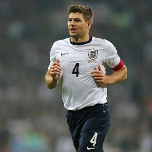 Steven Gerrard will wait until after the World Cup before deciding whether to end his international career
