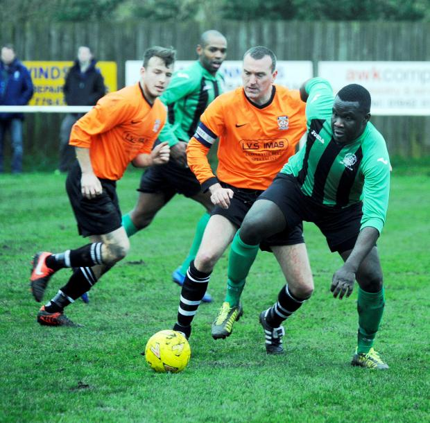 Tempest united's Alf Akiouto in action against Euxton Villa