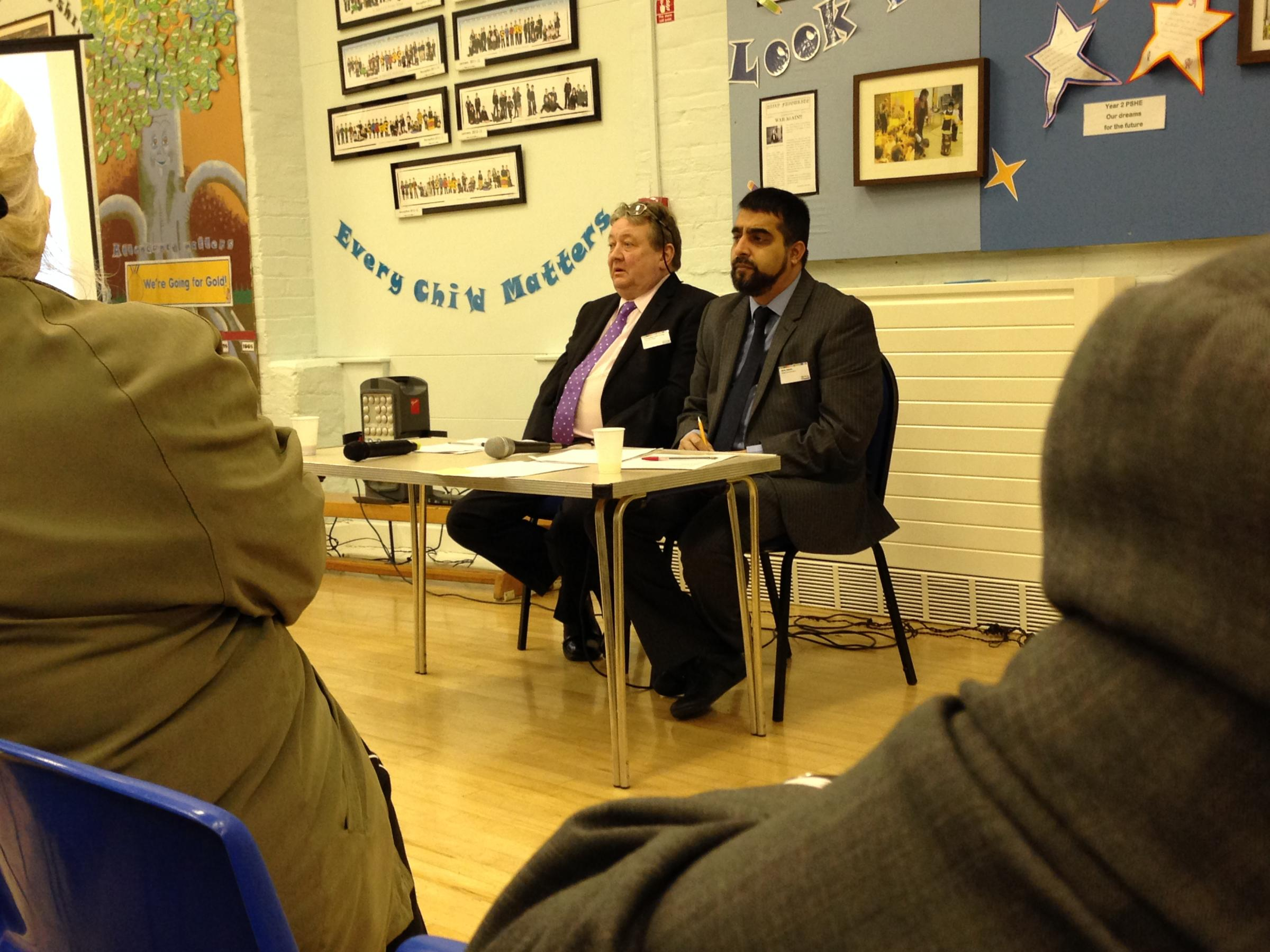 Kearsley area forum: (left to right) Cllr Liam Irving and area co-ordinator Idris Jeewa address residents at the meeting