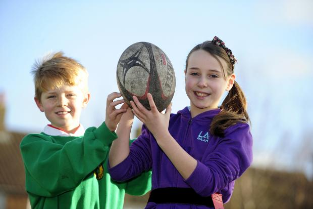 The Bolton News: Tag rugby players Jamie Farnworth and Charlotte Davenport, both aged 10