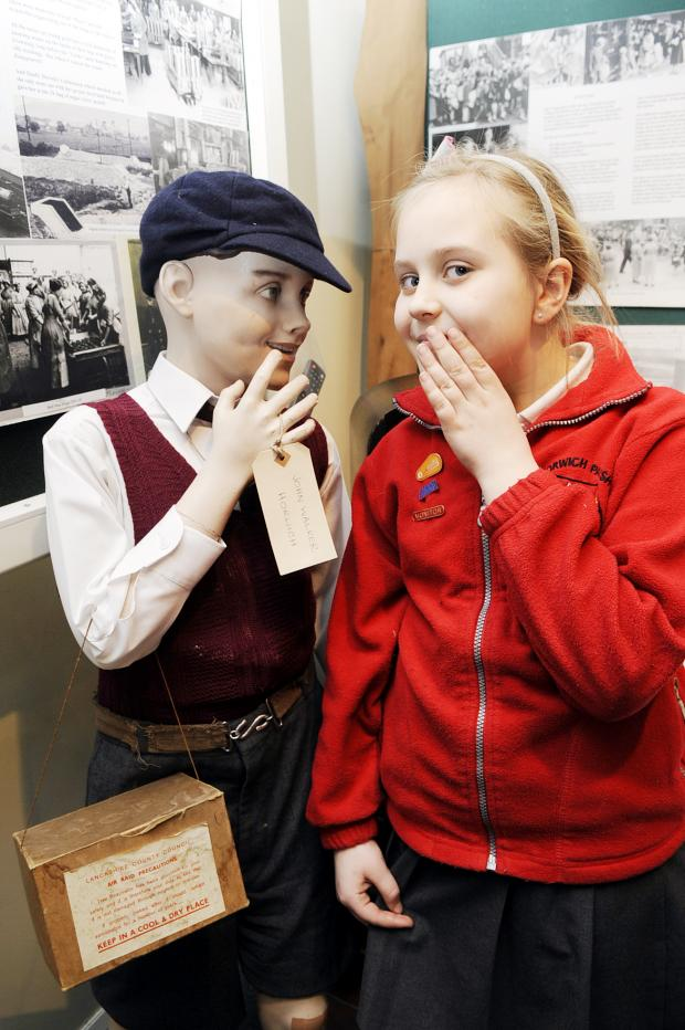 The Bolton News: Eve Bleasdale, aged 10, meets a young evacuee from the Second W