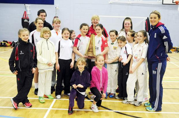 Charlotte Edwards with young girls cricketers at St Catherine's Academy