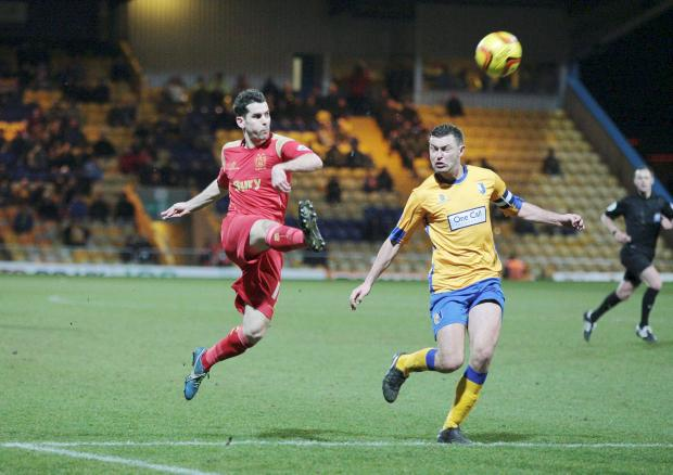 The Bolton News: Daniel Nardiello sends the ball on its way for his second goal in a 4-1 win at Mansfield Town on Tuesday night