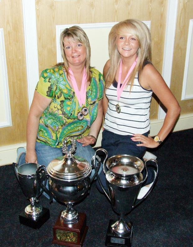 The Bolton News: Diana and daughter Lucy with footballing trophies